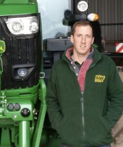 Matthew Williams farmer next to tractor