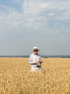 Gerald Osborne in a field of Nelson wheat