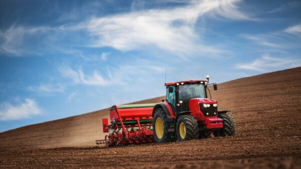 Tractor ploughing through field - Cope Seeds & Grain